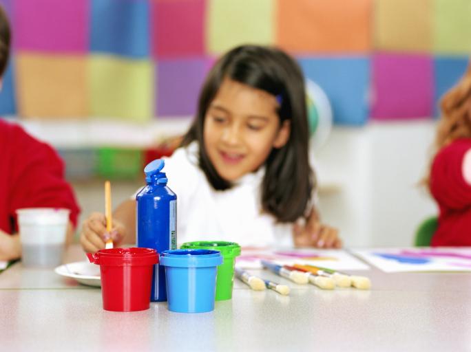 Schoolgirl Painting in a Classroom
