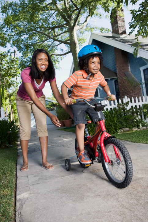 Mother Teaching a Boy to Ride a Bicycle