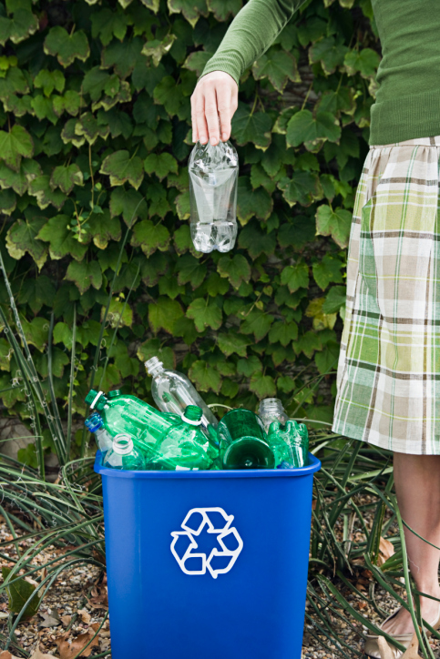 Woman Throwing Away Plastic Water Bottle