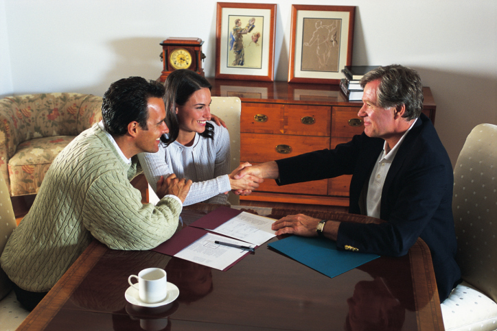 Couple meeting with Insurance Agent