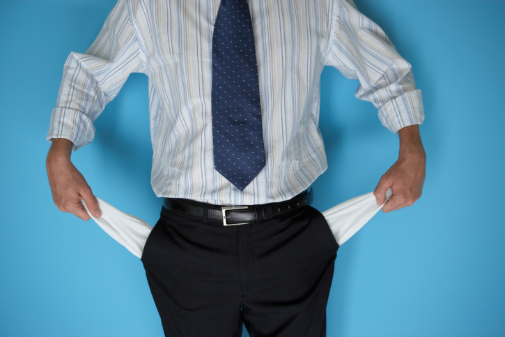 Businessman Holding Out Empty Pockets