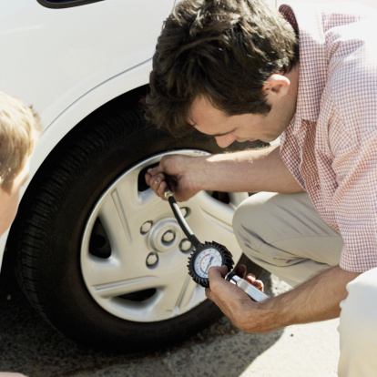 Dad Checking Tire Pressure