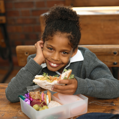 Girl Eating Packed Lunch