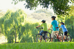 Family Riding Bikes To Relieve Stress