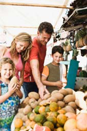 Family Making 'Green Choices' At Food Stand