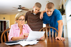Mother Reviewing 529 Plans With Sons