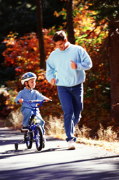 Dad Exercising With Son