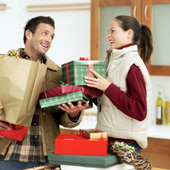 Couple Returning Home From Holiday Shopping