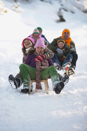 Family Sledding Outside