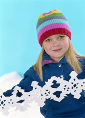 Young Girl Making Paper Snowflakes