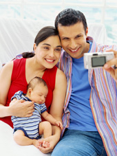 young American family taking a photograph