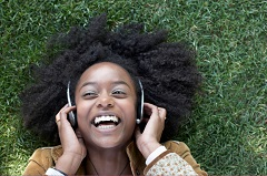 Happy Young Girl Listening to Music