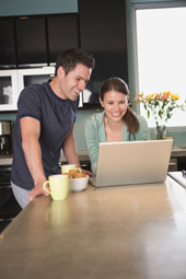 young adults using a computer to purchase life insurance
