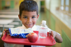 Boy Eating a Healthy School Lunch