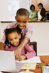 Brother Helping Sister With Homework
