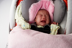 Crying Newborn in Car Seat