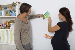 Expecting couple choosing a paint color for their nursery