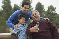Grandfather father and boy taking a picture
