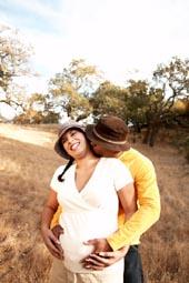 couple taking maternity photographs