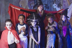Woman and children in Halloween costumes