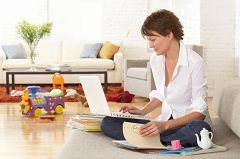 Mom Working on Laptop in Living Room