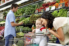 Young family buying healthy groceries