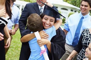 Little brother congratulating big sister on graduation