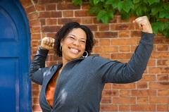 Woman Raises Hands Triumphantly