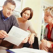 Couple Reviews Life Insurance Policy With Agent