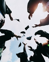 Students Throwing Their Mortar Boards in the Air at Graduation