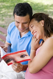 pregnant woman and man reading