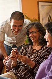 Family using cell phone