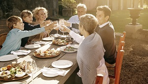 Family celebrating around dinner table