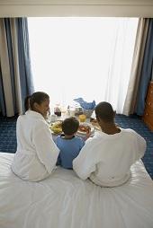 Family eating breakfast in hotel