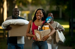 Young woman moving into dorm