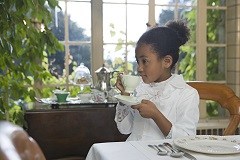 Young girl drinking tea