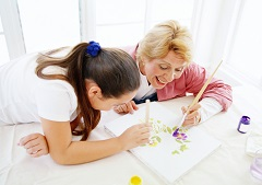 Grandma painting with granddaughter