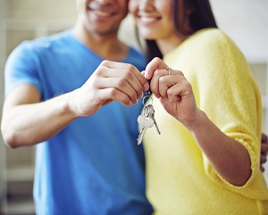 Couple holding keys from new home