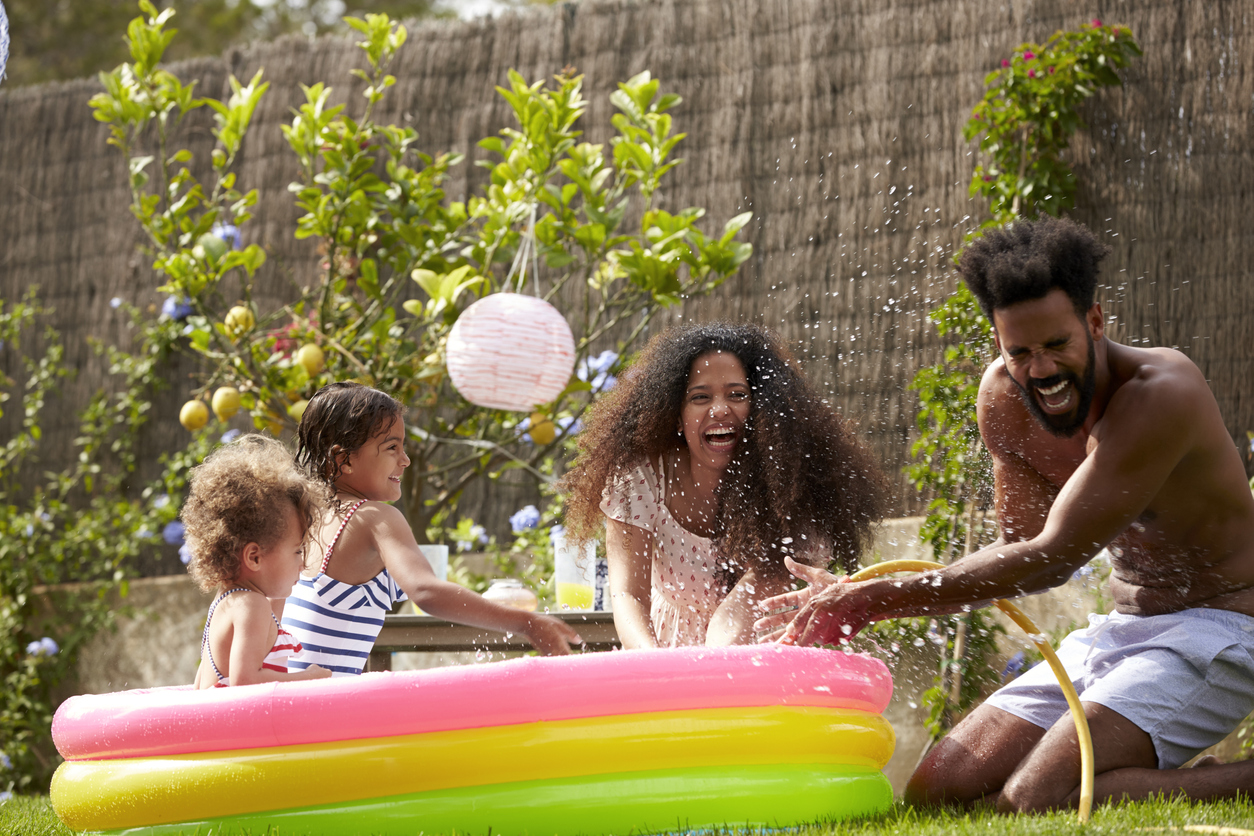 family playing in pool
