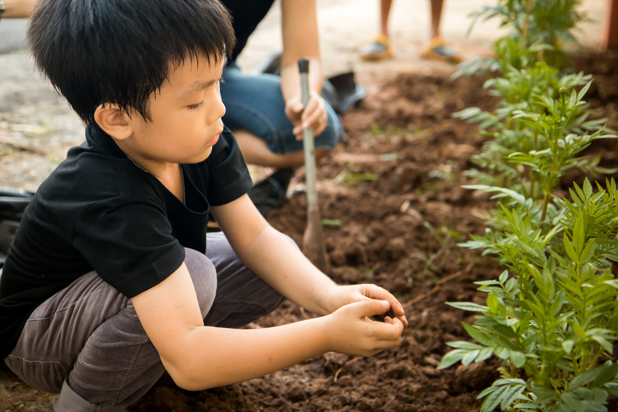 Earth Day for Kids - child gardening