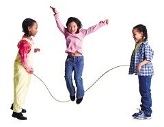 Three girls playing jump rope