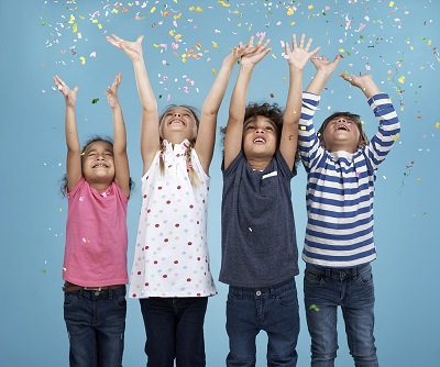 Children celebrating with confetti