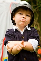 Boy wearing police hat