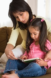 Mother and daughter reading together