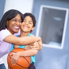 Mom hugging son with basketball