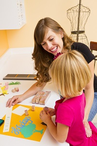 Mom and daughter scrapbooking together