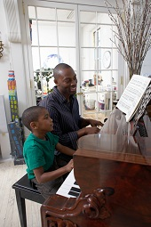 Father Teaches Son to Play Piano