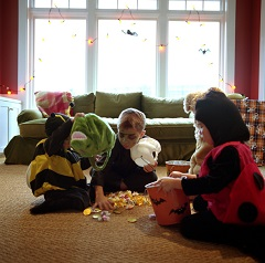 Children checking out candy from trick-or-treating