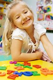 Preschool student smiles