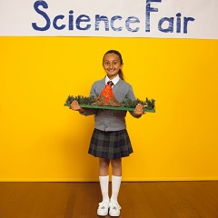 Girl holding science project